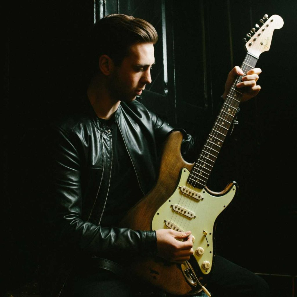 image of Laurence Jones holding his guitar