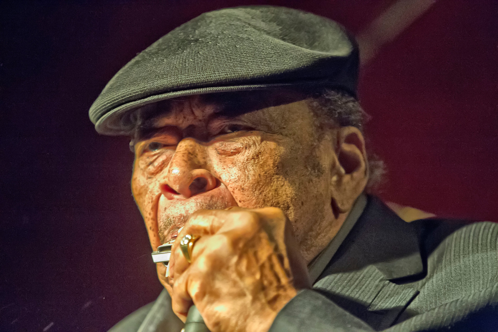 phot of James Cotton playing harp