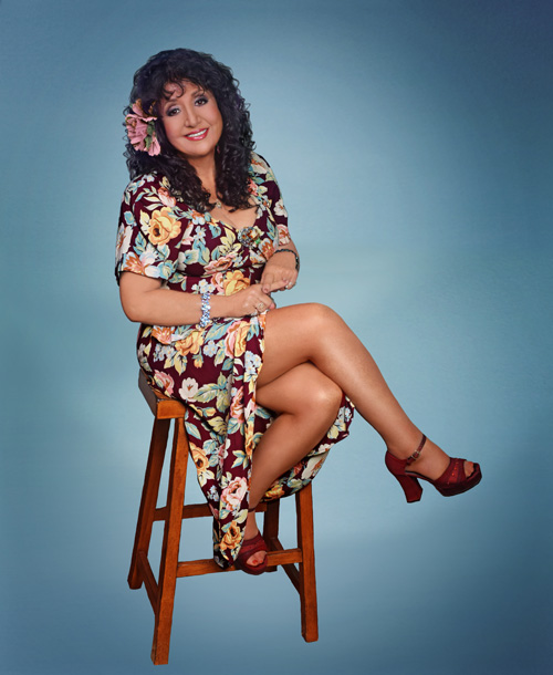 image of singer Maria Muldaur sitting on a chair