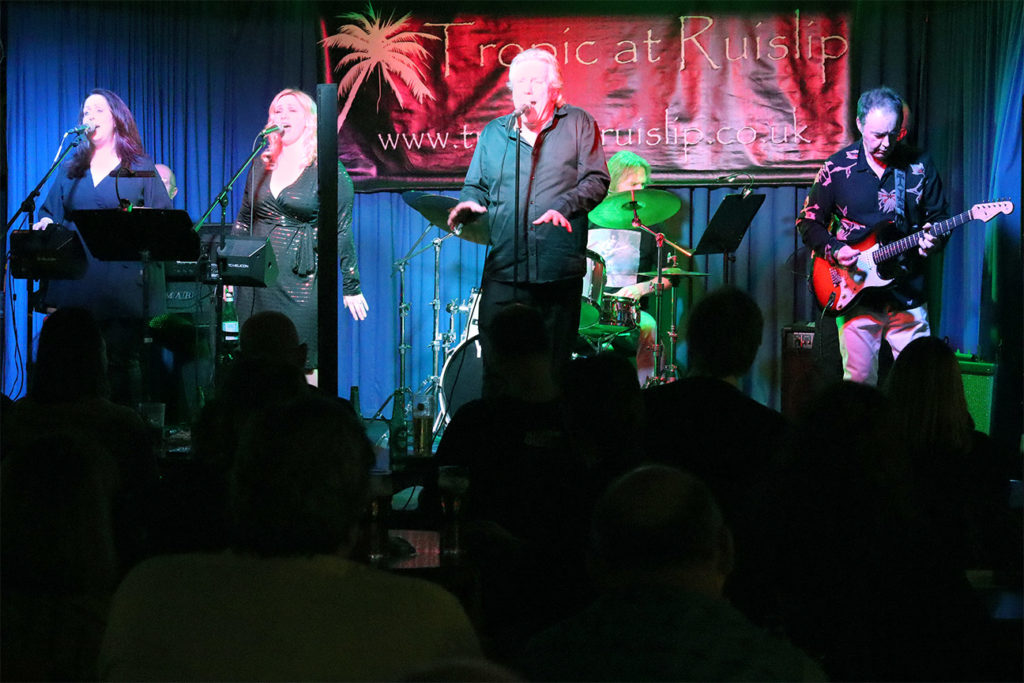 image of Paul Cox band on stage in London