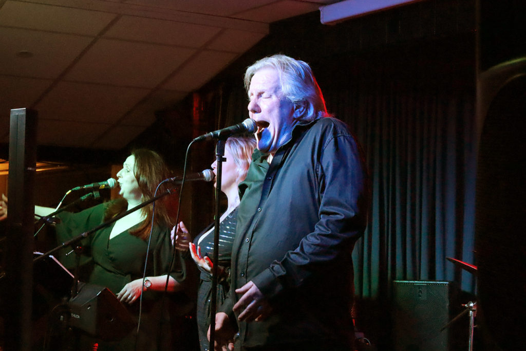 image of singer Paul Cox on stage