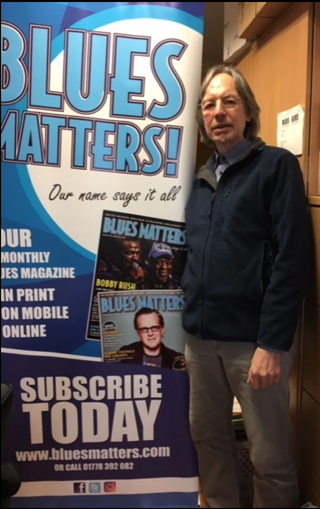 Alan Pearce from blues matters magazine standing by promo pop up banner