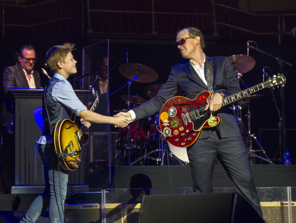 photo by zoran veselinovic of Toby Lee performing with Joe Bonamassa at Royal Albert Hall in London on April 24, 2019.