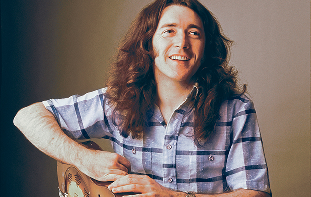 image of blues artist Rory Gallagher -National-Guitar-1977-photo-by-John-Prew