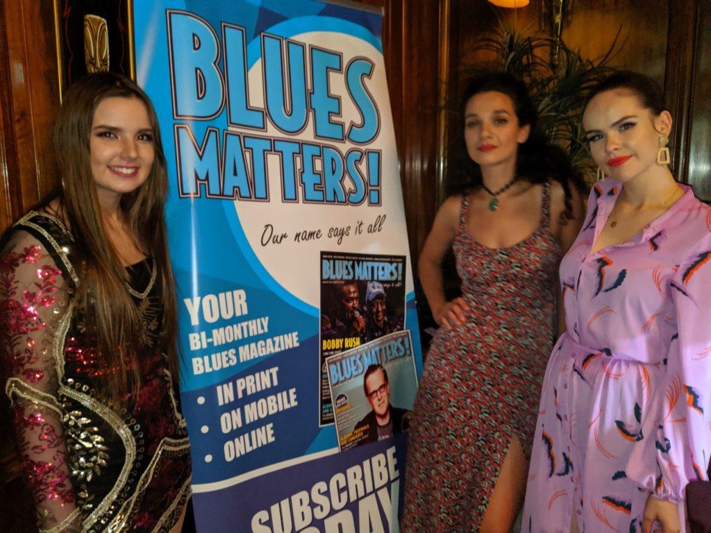 image of Blues caravan artists with blues matters pop up banner at edinburgh blues club