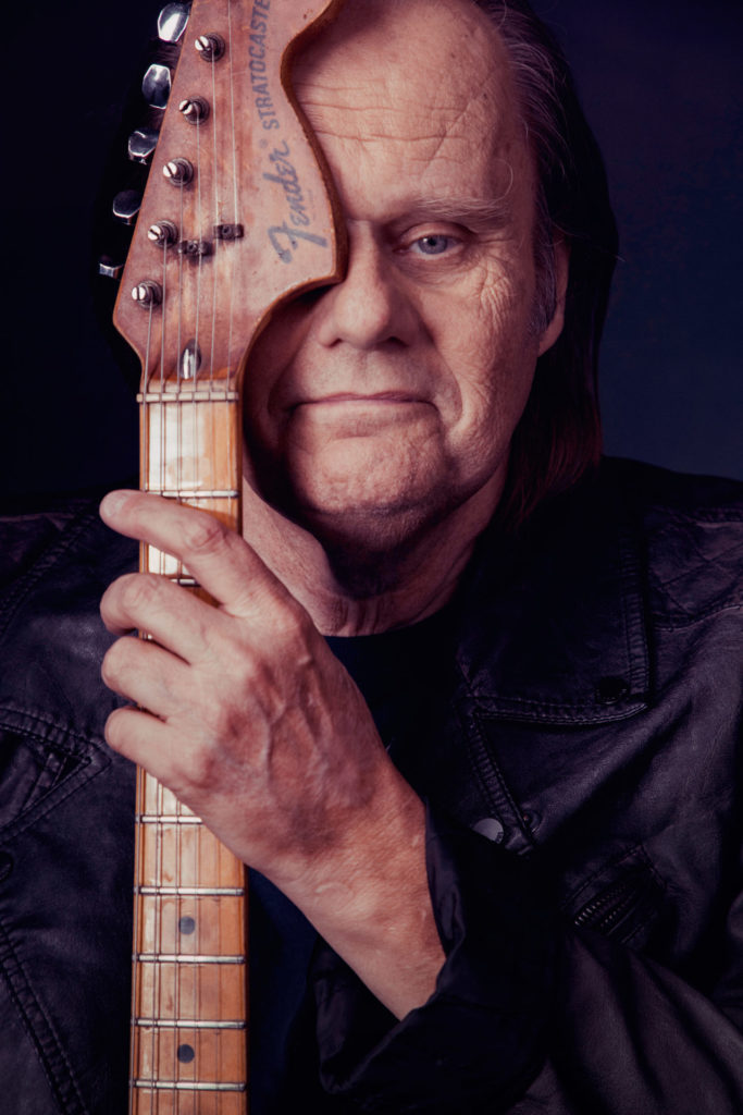 image of blue artist walter trout holding guitar